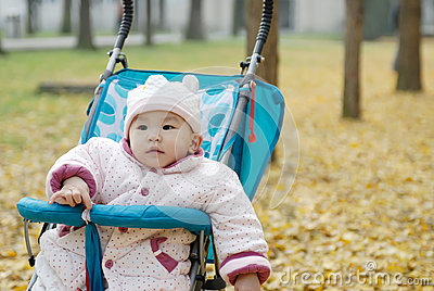 Chinese baby sitting in stroller