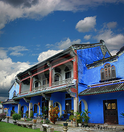 Chinese blue mansion under cloudy sky