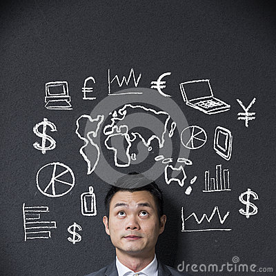 Chinese businessman in front of a diagram of business