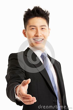 Chinese Businessman ReachingTo Shake Hand