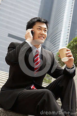 Chinese Businessman Talking On Mobile Phone