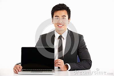 Chinese Businessman Working On Laptop