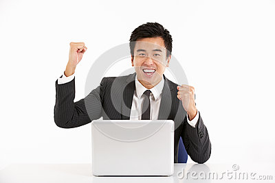 Chinese Businessman Working On Laptop And Celebra