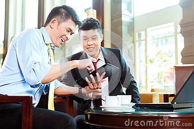Chinese businessmen at business meeting in hotel