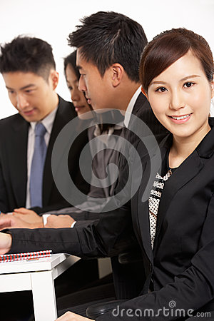 Chinese Businesspeople Having Meeting