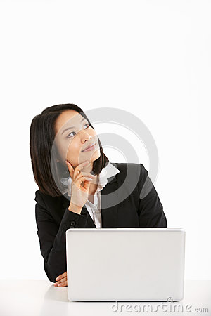 Chinese Businesswoman Working On Lapto
