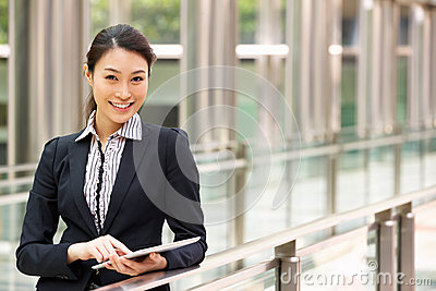 Chinese Businesswoman Working On Tablet Computer