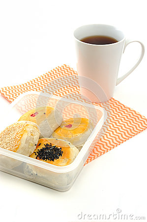 Chinese cakes with a cup of tea, asian style pastry.