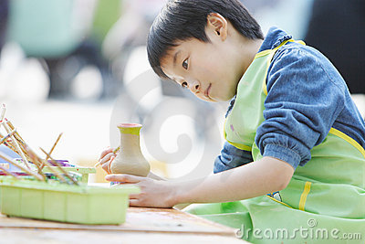 chinese child dedicated makes handwork