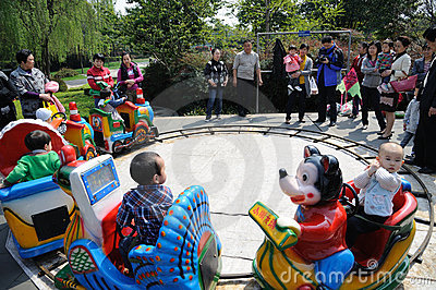 chinese children are playing toy train Editorial Stock Image