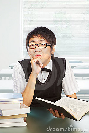 Chinese college male student studying
