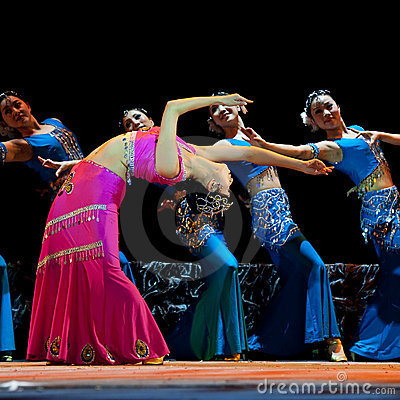 Chinese Dai ethnic dancers perform on stage Editorial Stock Image