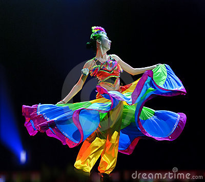 Chinese ethnic dancing girl Editorial Stock Image
