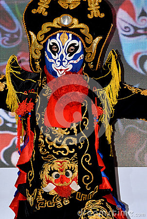 Chinese face changing performing and finery Editorial Image