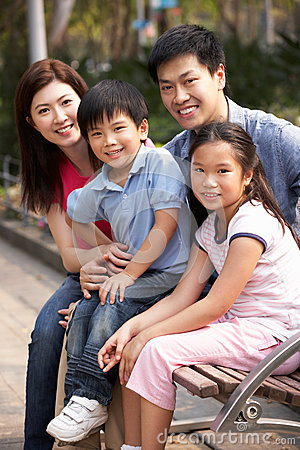 Chinese Family Walking Sitting On Bench In Park