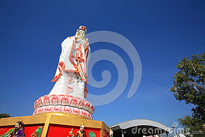 Chinese female god, Guanyin, against blue sky