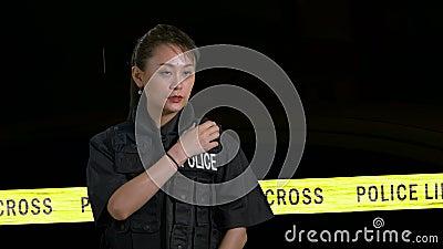 Chinese female police officer using radio