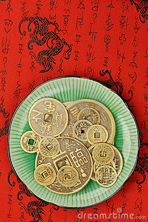 Chinese feng shui coins in a plate