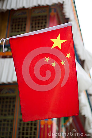 Chinese flag on a traditional Tibetan house