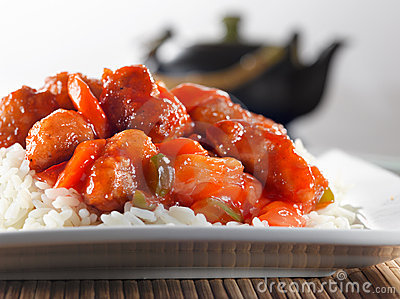 Chinese food - sweet and sour chicken on rice