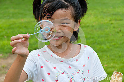 Chinese girl blow bubbles
