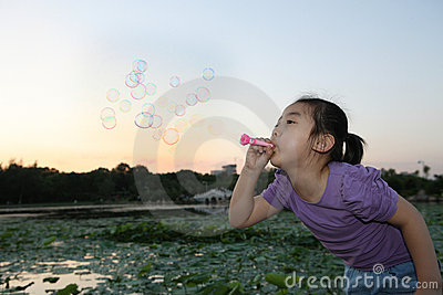 Chinese girl Blowing bubbles