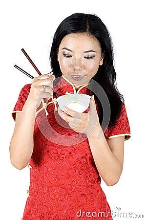 Chinese girl eating rice