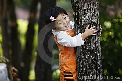 Chinese girl holding the tree
