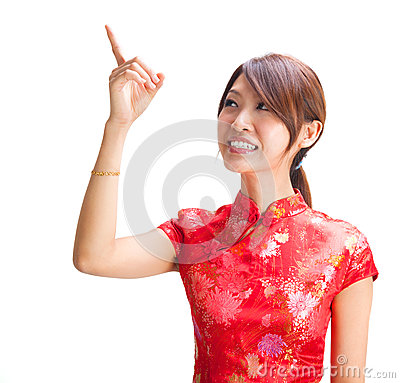 Chinese girl pointing at blank space