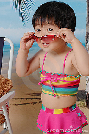 Chinese girl on the sand beach