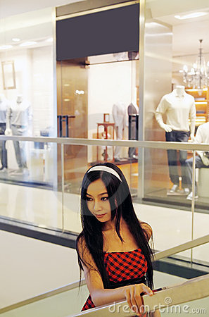 Chinese girl in shopping mall.