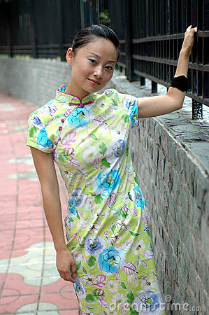 Chinese girl on sidewalk