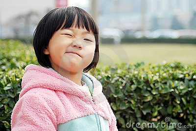 Chinese girl wearing a pink dress