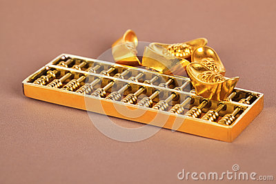 Chinese gold ingot and golden abacus