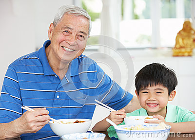 Chinese Grandfather And Grandson Eating Meal