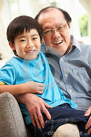 Chinese Grandfather And Grandson Relaxing