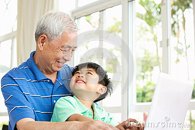 Chinese Grandfather And Grandson Using Laptop