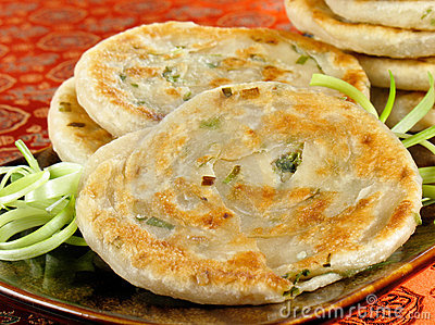Green onion pancakes are a fried Chinese flatbread eaten as a snack or ...