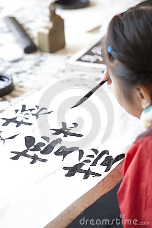Chinese kid practice calligrapy