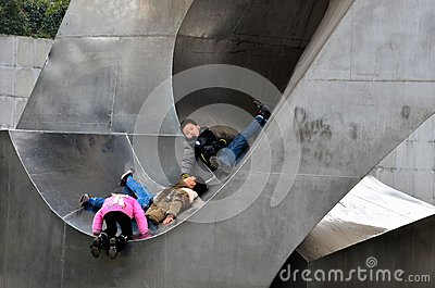 Chinese kids play in outdoor metal sculpture, Shanghai China Editorial Photo