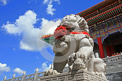 Chinese Lion statue against blue sky