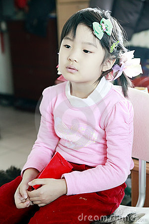 Chinese little girl watching TV