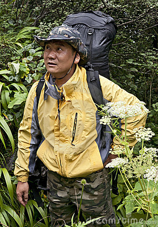 Chinese Man Backpacking Through Jungle