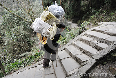 Chinese man carry goods Editorial Photo