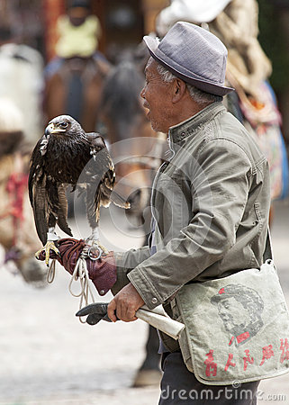 Chinese Man with Eagle Editorial Photo