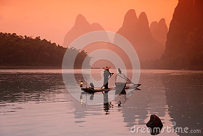 Chinese man fishing with cormorants birds Editorial Photography