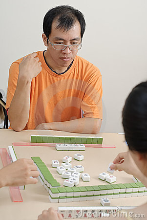 Chinese man play Mahjong