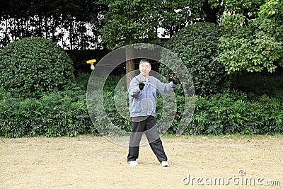 Chinese man playing Yo Yo game Editorial Image