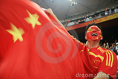 Chinese man screaming with chinese  flag Editorial Stock Photo