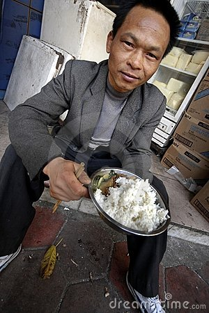 Chinese men eat on street Editorial Photography